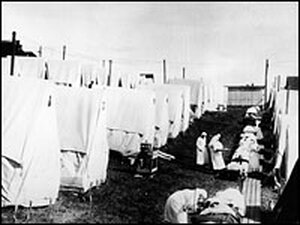 Nurses care for 1918 Spanish flu patients in tents.
