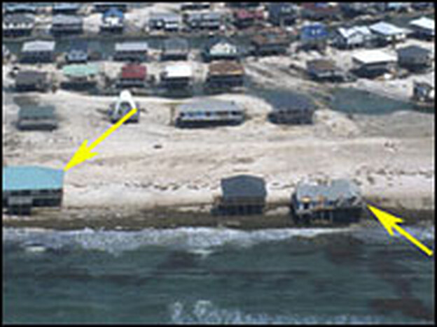 This aerial photo shows Dauphin Island in August 2005 after several hurricanes washed away its coastline.  Click to see aerial photos showing the island in 2001, 2004 and 2005.