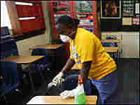 Fort Worth Independent school district custodian Necie Homer wipes down a classroom with disinfectan