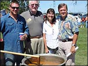 Standing around the BBQ pot at a union-sponsored picnic in Owensboro, Ky.