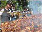 Men at work: The barbecue team at Blessed Mother Catholic Church in Owensboro, Ky.