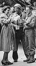 U.S. soldiers are served coffee during World War II
