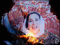 Mourners hold candles during a ceremony for Benazir Bhutto in Lahore, Pakistan.