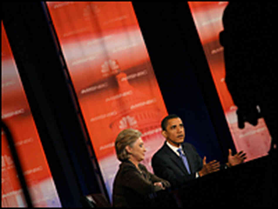 Hillary Clinton and Barack Obama participate in a debate in Cleveland on Tuesday.