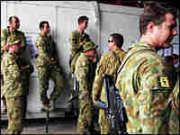 Australian troops look on as Australian Prime Minister Kevin Rudd visits in Dili, East Timor.