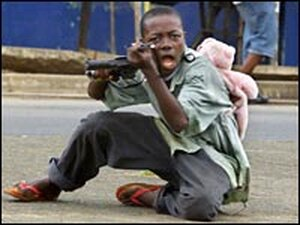 Child soldier on the streets of Monrovia, Liberia, June 2003.