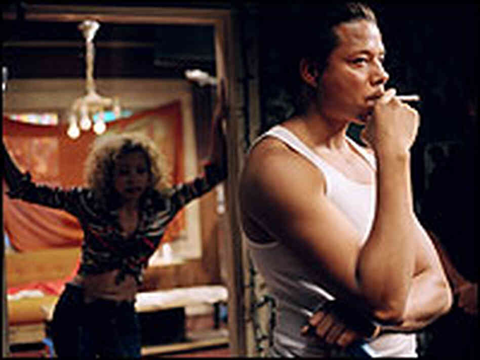 A brooding Terrence Howard smokes a cigarette in 'Hustle & Flow'