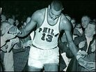 Detail from the cover of 'Wilt, 1962' showing the exhausted NBA star leaving the court.