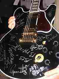 A copy of King's beloved guitar Lucille, signed by other famous musicians