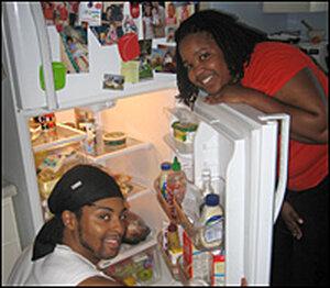 Personal trainer Gregg Butler helps Farai Chideya make room for healthy foods.
