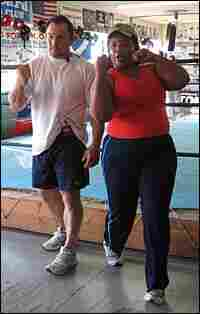 Justin Fortune, left, is one of the most sought-after boxing trainers in the business.