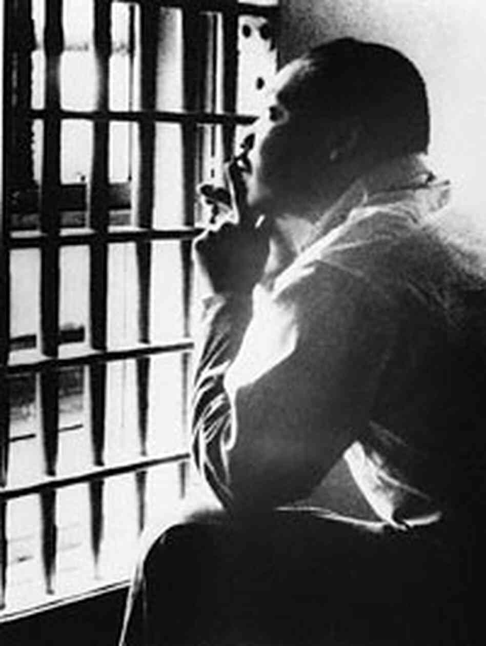 The Rev. Martin Luther King, Jr., sits in a jail cell, October 1967.
