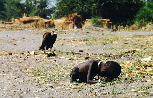 A vulture watches a starving child in southern Sudan, March 1, 1993.