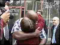 Timothy Atkins embracing Windy Koen