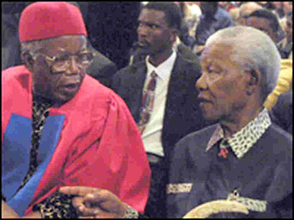 Chinua Achebe sitting next to Nelson Mandela