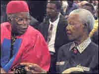 Chinua Achebe sitting next to Nelson Mandela