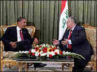 Barack Obama talks with Iraqi President Jalal Talabani