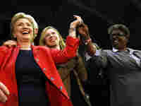 Hillary Clinton celebrates with her daughter, Chelsea Clinton, and Rep. Stephanie Tubbs Jones