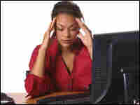 Woman sitting at computer, stressed out