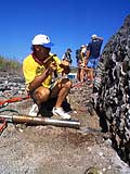 El Nino researcher Jerry Wellington drills core samples from an uplifted coral