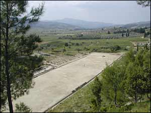Nemea's restored stadium, a long rectangle surrounded by embankments