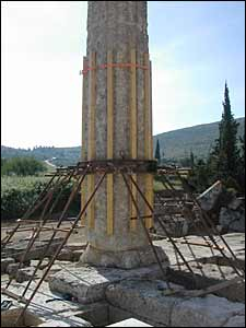 A rebuilt column of Nemea's Temple of Zeus, supported by wooden and metal struts.
