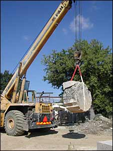 A crane lifts a limestone