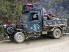A customized truck on the winding mountain roads of Yunnan Province.