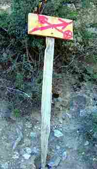 A simple sign points the way to the next destination along the pilgrimage trail.