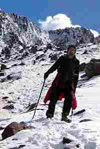 Bill McQuay carefully makes his way down from Shula Pass -- the last mountain pass on the pilgrimage