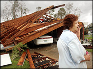 Cathy Breazeale of Gulfport, Mississippi surveys damage to her home caused by Hurricane Katrina.