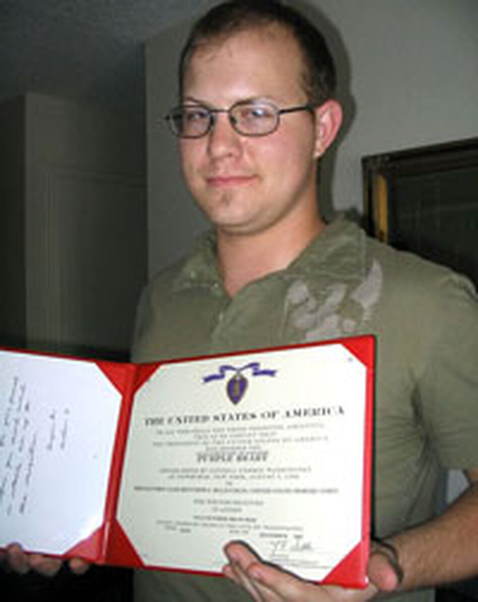 Matt McLauchlen, shown here holding a certificate for his Purple Heart, spent months in military hospitals after a rocket explosion in Iraq almost severed his spinal cord and caused permanent disabilities. When he told a colonel he was so depressed that he had smoked marijuana, commanders at Camp Pendleton sent him to court martial — and discharged him with only partial benefits.
