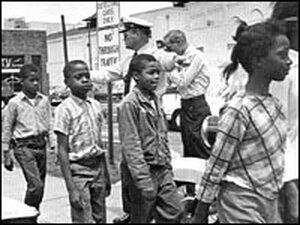 Policemen lead school children to jail for protesting discrimination in Birmingham, Ala., 1963.
