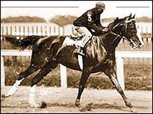 Jimmy Winkfield aboard a horse
