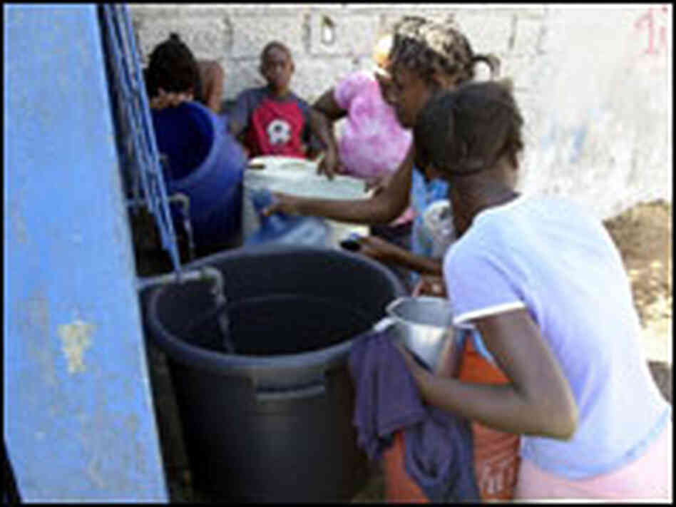 Haitians get water. THONY BELIZAIRE/AFP/Getty Images.