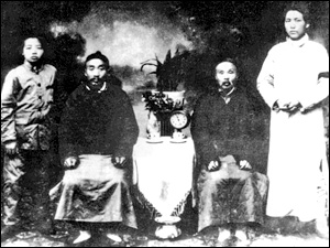 Mao Tes-tung (right), wearing a black armband just after the death of his mother.
