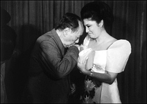 Flirting with the Philippines' first lady Imelda Marcos, 1974.