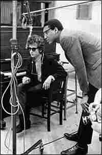 Dylan with producer Tom Wilson in the studio that day.