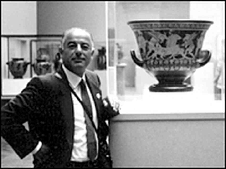 Giacomo Medici, photographed alongside the Euphronios krater in the Metropolitan Museum of Art.