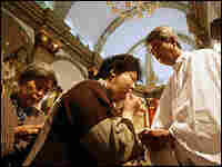 Catholics receive Holy Communion at Beijing's Immaculate Conception Cathedral.