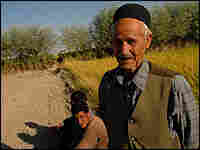 Village elder Jaafar Hosseini with workers near a rice field outside of Isfahan