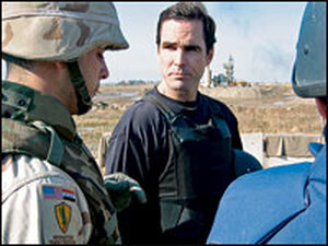Woodruff standing with troops.