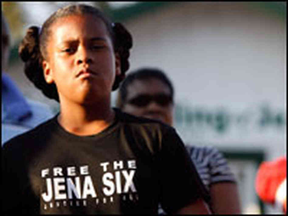 A girl listens to Rev. Al Sharpton speak before a civil rights march in Jena, La. on Thursday.