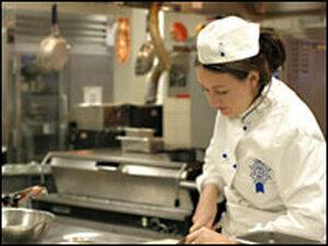 Chef Kathleen Flinn works in the kitchen.
