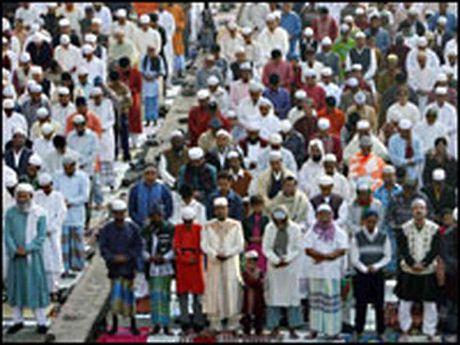 A large crowd of Muslim men take part in a special morning prayer in Dhaka, Bangladesh