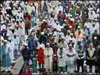 A large crowd of Muslim men take part in a special morning prayer in Dhaka, Bangladesh