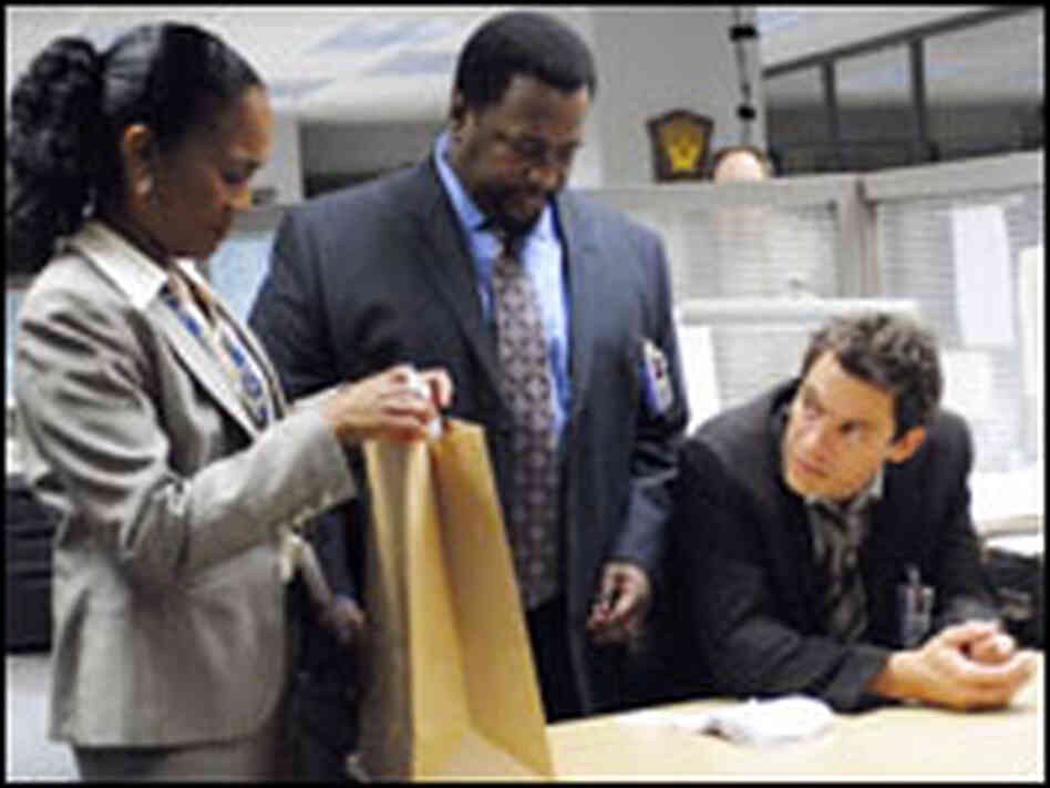Actors Sonja Sohn, Wendell Pierce, Dominic West in HBO's The Wire.