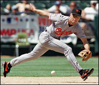 Ripken stretches to reach a ground ball during a 1997 game against the Oakland Athletics.