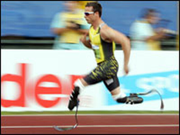 """Paralympic athlete Oscar Pistorius has been dubbed """"The Cheetah"""" — he sprints on carbon fiber artificial limbs called the Cheetah Flex-Foot. (AFP/Getty Images)"""