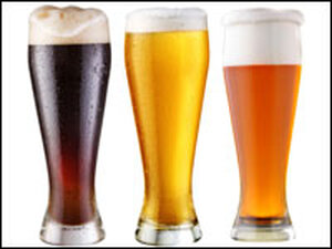 Three tall glasses of beer.